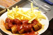 Currywurst aus Berlin: Das Gastronomie-System Curry Wolf stellt sich potenziellen Franchise-Gründern vor